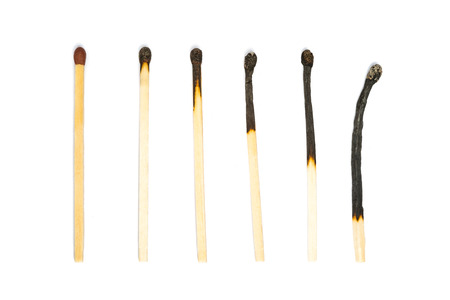 unused: One unused match and several burned matches.