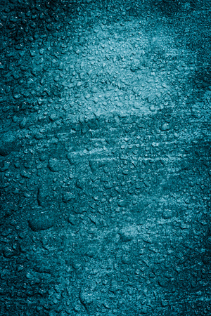 condensate: Wet blue concrete background with selective focus. Stock Photo