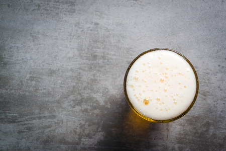 top down: Glass of beer on a concrete table