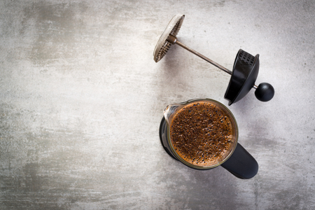 with coffee maker: French press coffee maker on concrete table