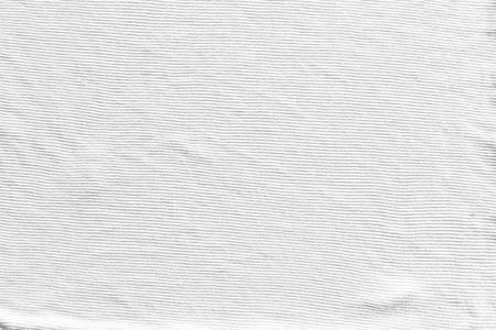 抽象的な白いニット布のテクスチャ背景