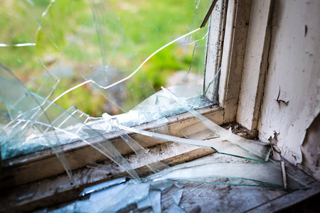 Window with broken glass in the window frame