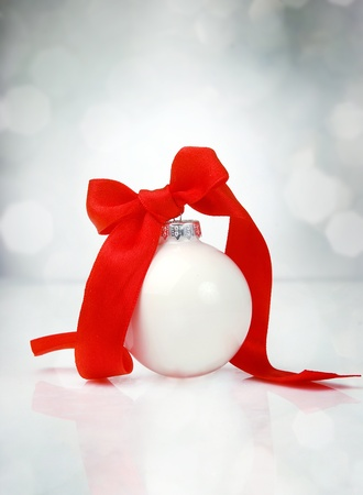 Christmas ball with ribbon on silver background  photo