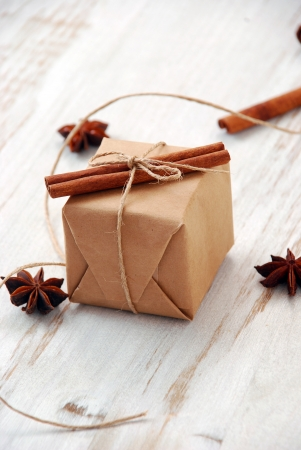 wrapped present: Vintage Christmas gift box on white wooden background