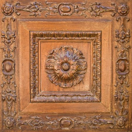 wood texture background: A flower carved in wood. Door decoration