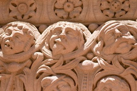 heads old building facade: Emotions carved in stone. Facade of historic building - Old Toronto City Hall Stock Photo