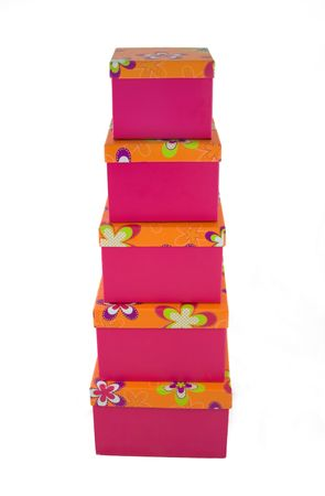 A huge stack of pink with orange flowered top presents. photo
