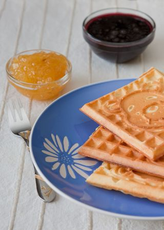 Three hot belgian waffles with gems