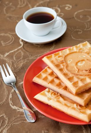 Three hot belgian waffles with coffee Stock Photo