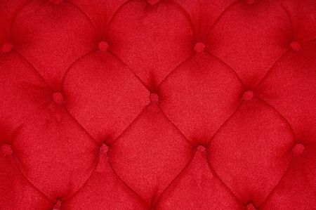 upholster: Closeup of a red cushion with buttons