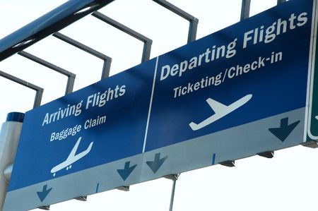 jetliner: Arrival and departure sign outside an airport