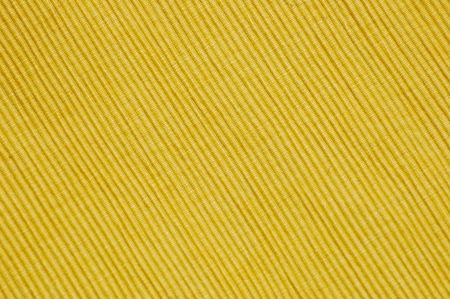 Close-up of a yellow place mat texture for backgrounds