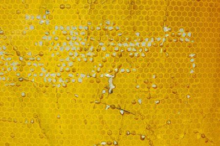 Closeup of damaged yellow reflector tape Stock Photo