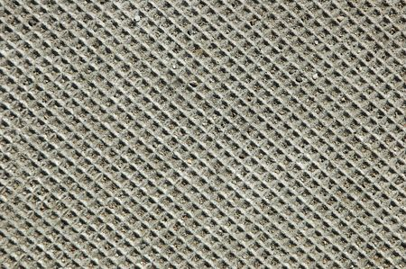 Closeup of a textured concrete electrical cover