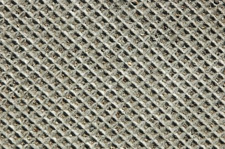 indentation: Closeup of a textured concrete electrical cover
