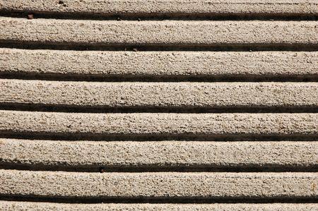 Einbuchtung: Closeup von Zeilen in eine konkrete B�rgersteig