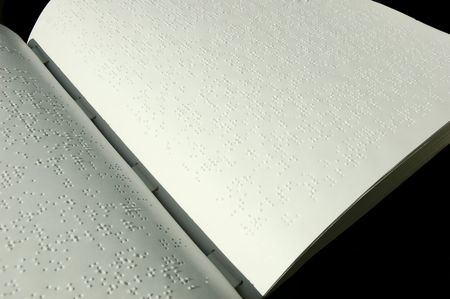 visually: Closeup of a Bible written in Braille