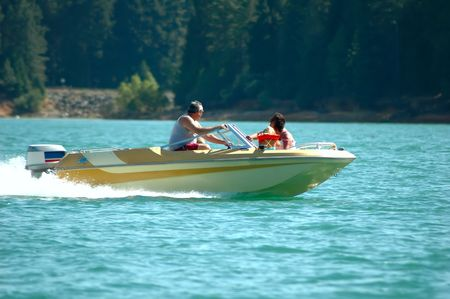 Family riding in a motor boat on a mountain lake
