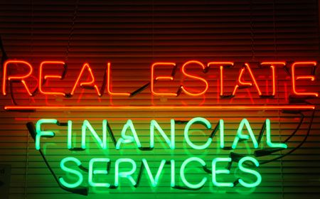 Real Estate  Financial Services neon sign Stock Photo