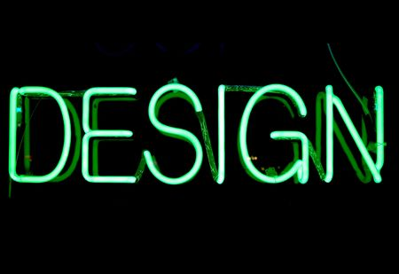 advertising material: Green neon sign with the word Stock Photo