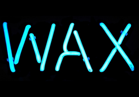Blue neon sign with the word Wax photo