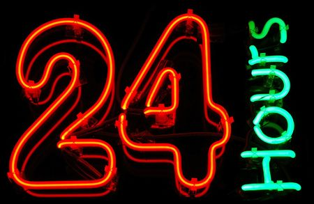 shop sign: 24 Hours neon sign Stock Photo