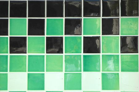 Old ceramic tile in green, black and white Stock Photo - 600149