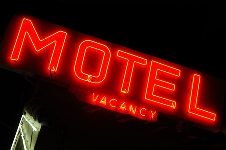 Motel sign lit up at night photo