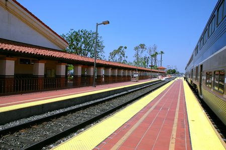 Train stopped along a platform at a station
