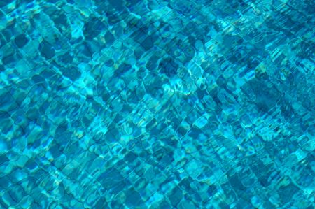 Tiles underwater in a swimming pool photo