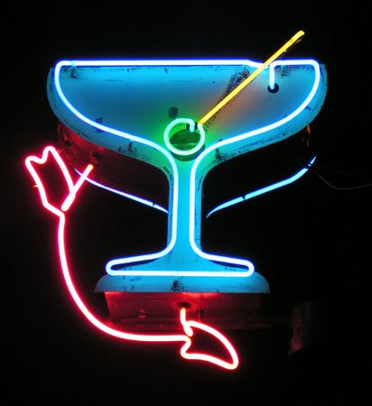 old sign: Neon martini glass with arrow sign
