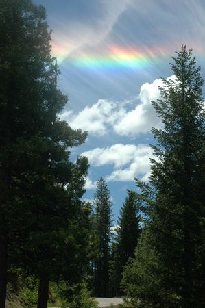 Sundog in the sky above a road in the mountains photo
