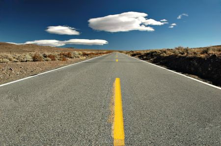 Empty road in the middle of the desert, Eastern Sierra Mountains, California photo