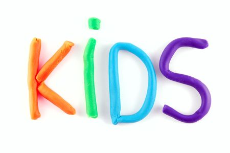 Kids written using childs clay isolated on a white background