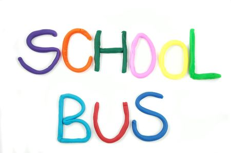 School Bus written using childs clay isolated on white background photo