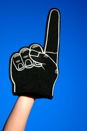 #1 foam finger raised and isolated against the blue sky Stock Photo