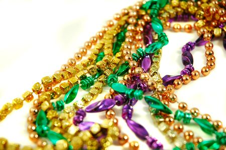 Strands of Mardi Gras beads isolated on a white background Stock Photo
