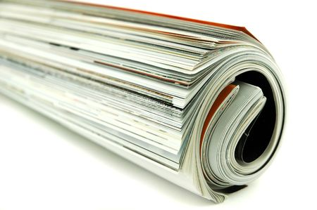 Magazines rolled up on an isolated background