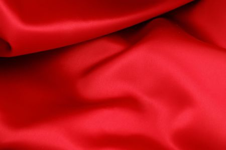 Piece of red satin fabric for a background texture Stock Photo