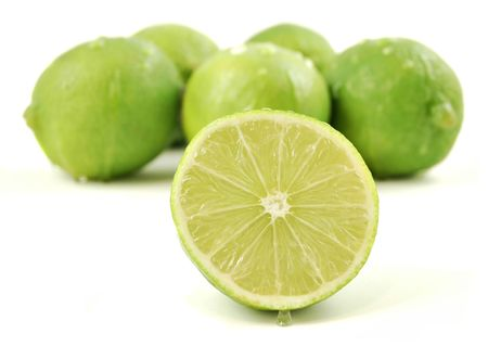 Bunch of fresh limes isolated on a white background