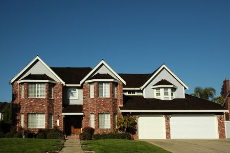 residential neighborhood: Brand new single family home located in a residential neighborhood Stock Photo