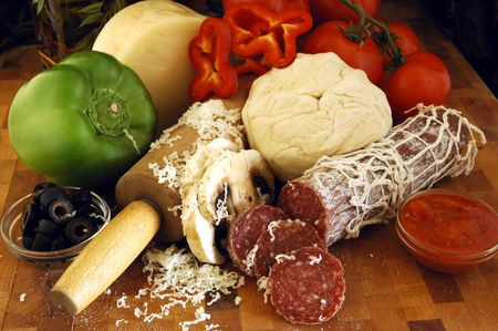 A variety of fresh ingredients for pizza photo