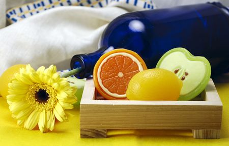 Wooden dish with three soaps in the shape of an apple, orange and lemon Reklamní fotografie