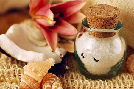 Jar of bath salts with tropical lily, coconut, and seashells