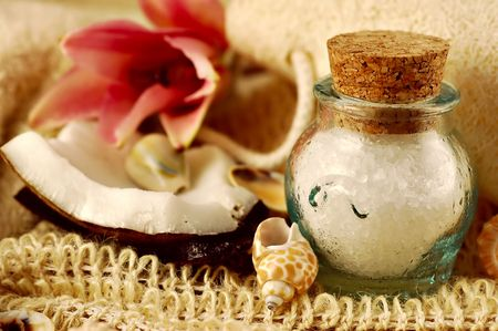 Bath salts with tropical shells, coconut and pink lily photo