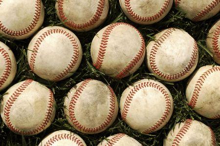 Nostalgic baseballs in the grass on a baseball field  photo