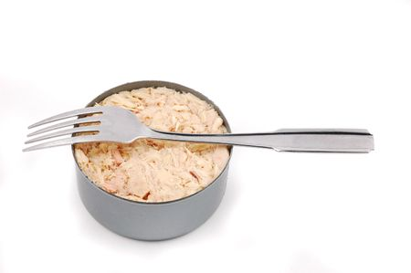 Open can of tuna fish with fork isolated on a white background photo