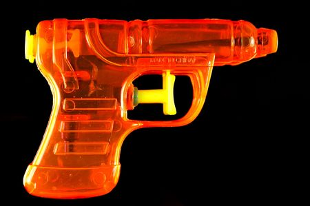 mirrored: Toy squirt gun isolated on a black mirrored background