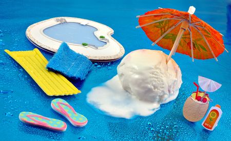 mini umbrella: Scoop of vanilla ice cream trying to stay cool in the summertime