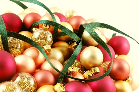 Pile of small Christmas ornaments with ribbon woven through